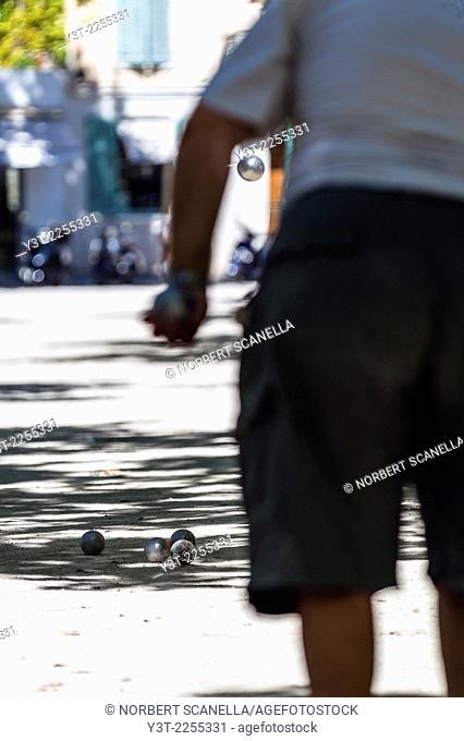 Europe, France, Var, Saint-Tropez. Place des lices. Man Playing Boules