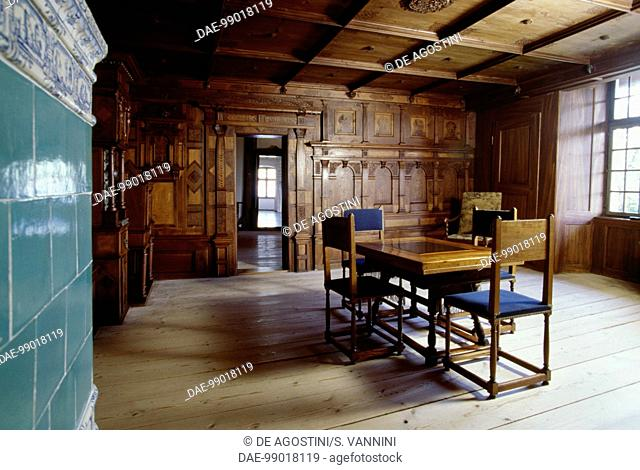 Room with wood paneling and a tiled stove, Spiez Castle, Canton of Bern, Switzerland