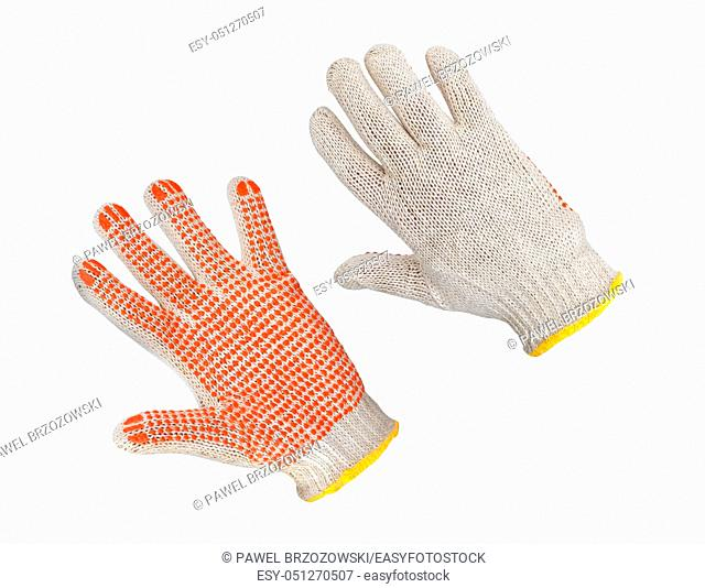 Cotton gloves with orange rubber on white background. Safety gloves isolated on white background. Protective worker gloves