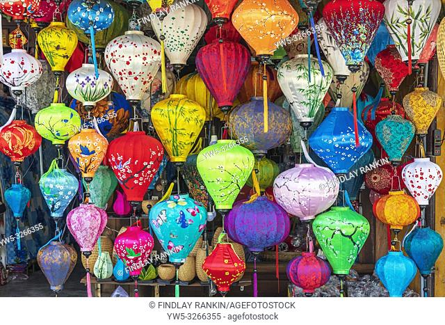 Selection of colourful and printed silk lanterns for sale at a market stall, Hoi An, Quang Nam Provence, Vietnam, Asia