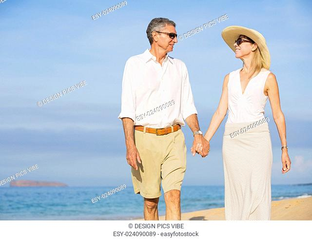 Happy Romantic Middle Aged Couple Enjoying Walk on the Beach