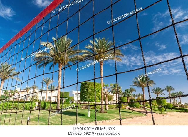 volleyball net on a background blue sky and clouds