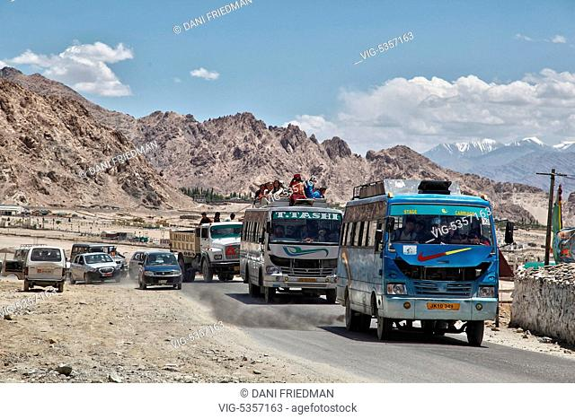 Ladakhi Buddhist pilgrims travel from the town of Choglamsar to the city of Leh after listening to His Holiness the 14th Dalai Lama perform prayers during the...