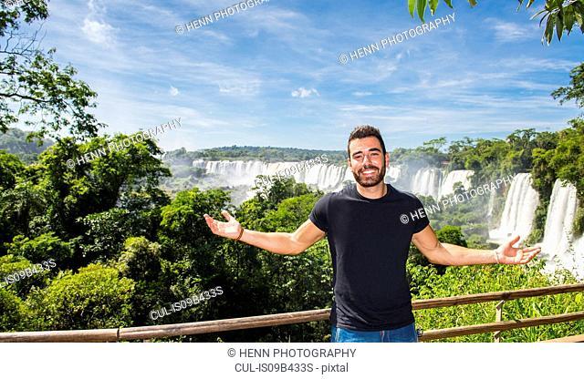 Man posing in front of Iguazu falls, Misiones, Argentina