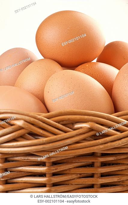 A wicker basket full of brown free range eggs