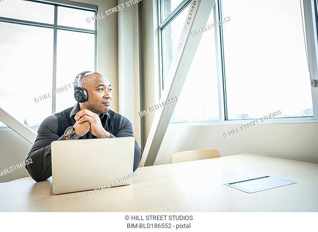 Black businessman using laptop in office
