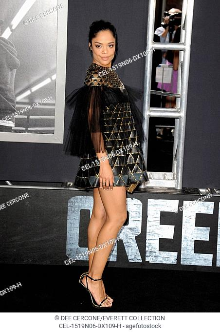 Tessa Thompson (wearing a Valentino dress) at arrivals for CREED Premiere, The Regency Village Theatre, Los Angeles, CA November 19, 2015