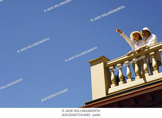 Low angle view of a mid adult couple standing on a terrace