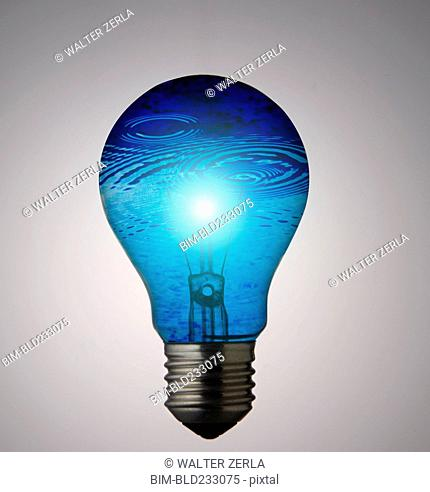 Blue water rippling in lightbulb