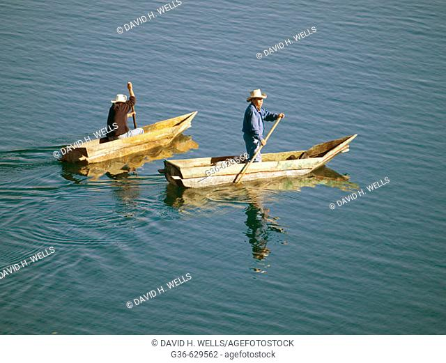 Fishermen at work on Lake Atitlan, which is a lake surrounded by three volcanoes in Santiago Atitlan, in the highlands of Guatemala, in Santiago Atitlan