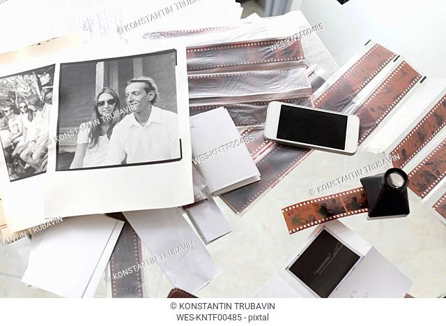 Photographies and film strips on desk