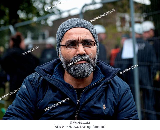 Mostafa Aliverdipour sits in his wheelchair outside his home in Sweets Way after being evicted by bailiffs. Activists protesting against the eviction were...