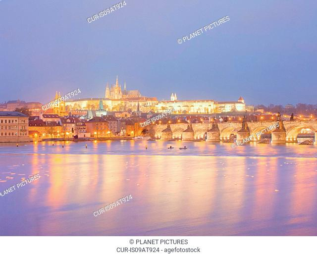 View of St Vitus Cathedral and Charles Bridge at dusk, Prague, Czech Republic
