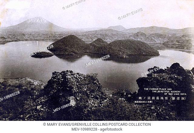 Lake Toya - a volcanic caldera lake in Shikotsu-Toya National Park, Abuta District, Hokkaido, Japan - the stratovolcano Mount Usu lies on the southern rim of...
