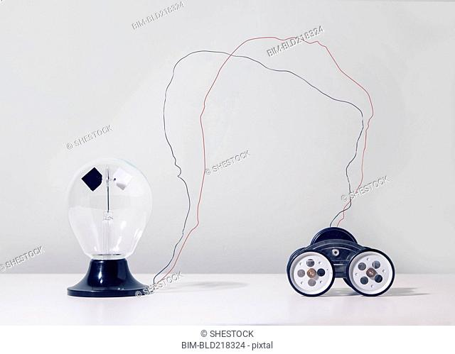 Wire connecting toy car to light bulb