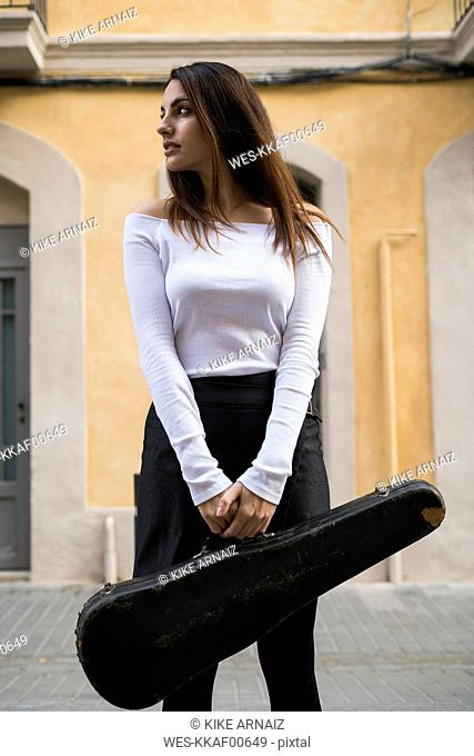 Young woman with violin case
