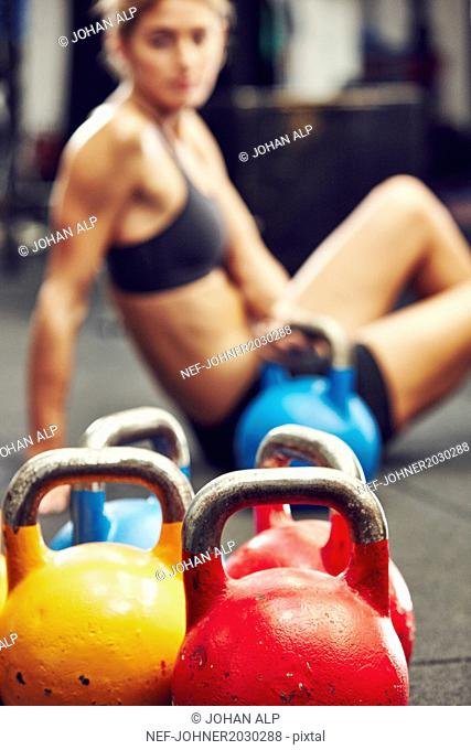 Kettlebells, woman on background