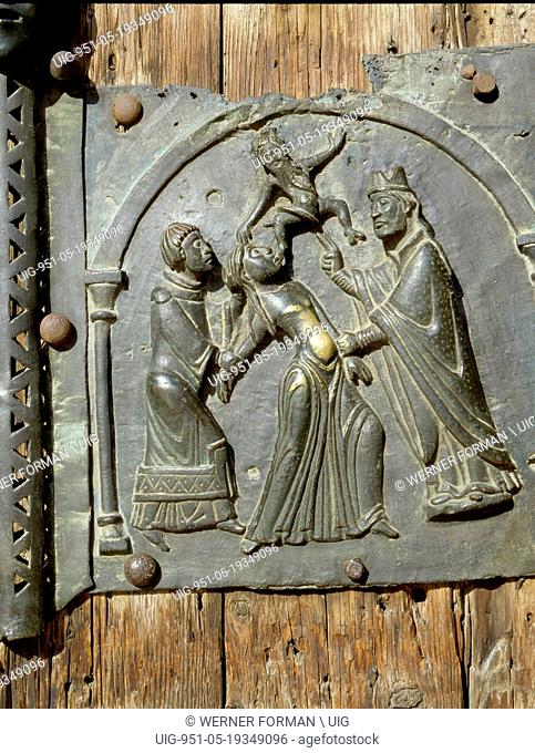 Detail of the bronze door of the Basilica of San Zeno which is decorated with 48 panels illustrating biblical stories and the lives of St Peter, St Paul