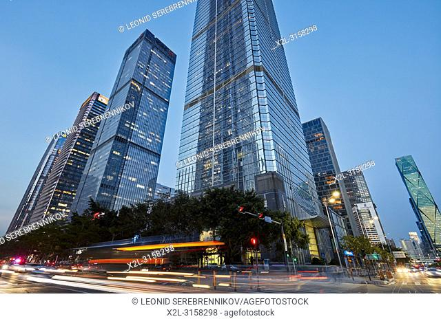 High-rise buildings in Futian Central Business District (CBD) illuminated at dusk. Shenzhen, Guangdong Province, China