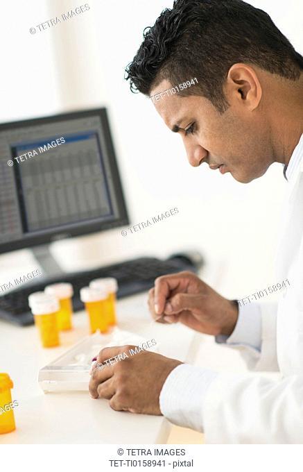 Pharmacist preparing prescription medicine
