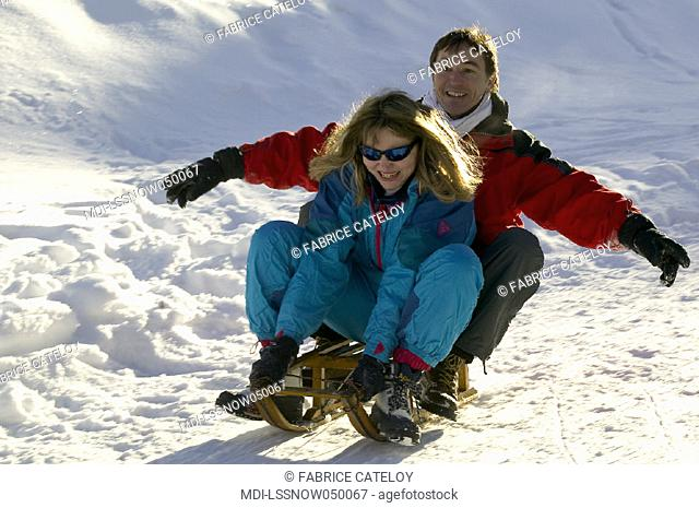 Woman and man doing sledge