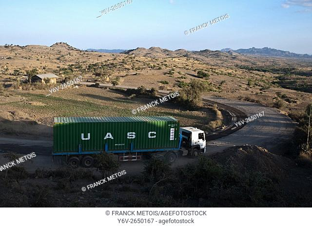 Truck plying on a road in the Amhara state ( Ethiopia). The truck is carrying a container. It is plying on one of the three roads connecting the port of...