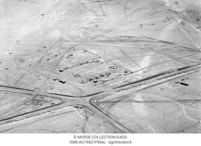 Aerial view shot from an airplane of buildings, roadways and tarmacs in the Sinai desert, Gaza, Israel, November, 1967