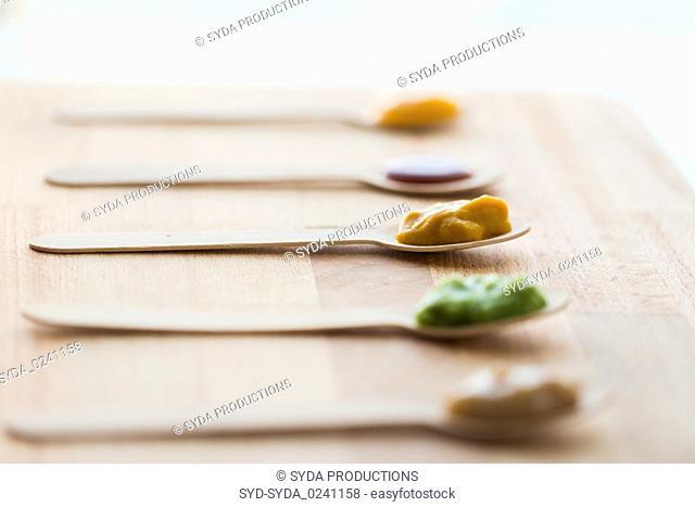 vegetable or fruit puree or baby food in spoons