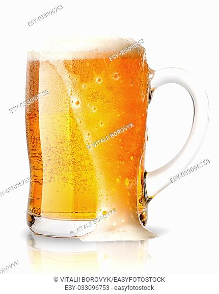 Light beer with foam in mug isolated on white background