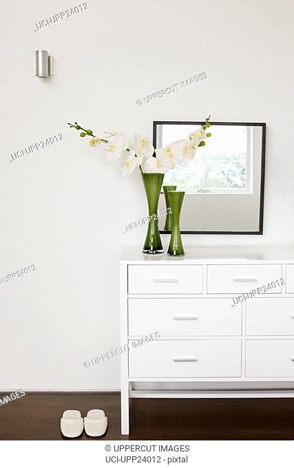 Vase of flowers on bedroom dresser