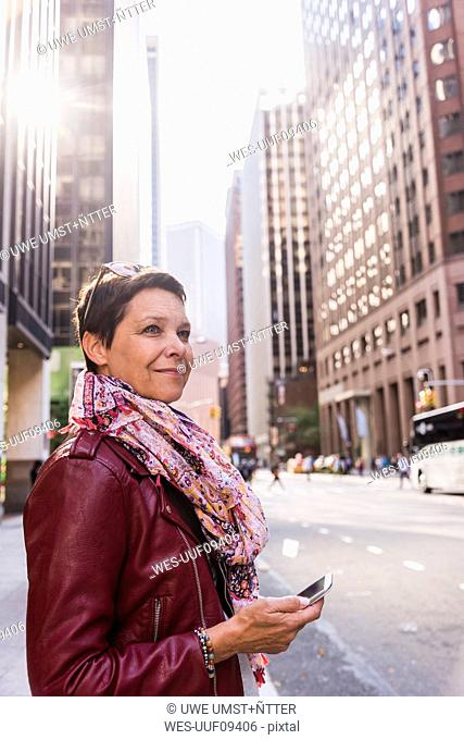 USA, New York City, smiling woman in Manhattan