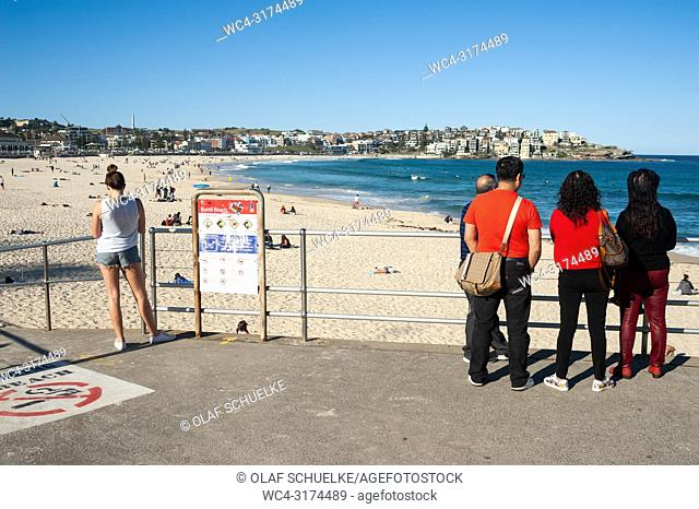 21. 09. 2018, Sydney, New South Wales, Australia - Tourists are seen standing at an entrance to Sydney's famous Bondi Beach looking at the sea
