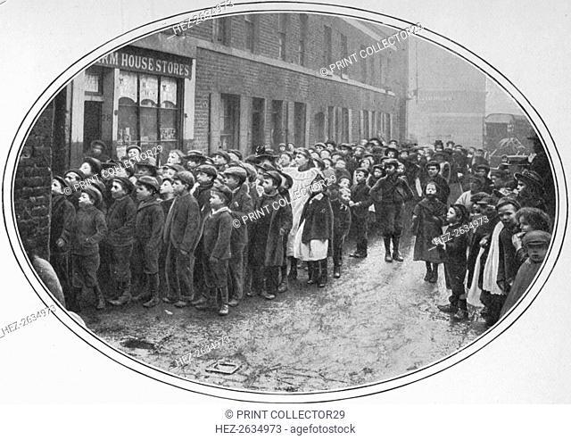 Children waiting for free meals, London, c1900 (1901). Artist: Unknown