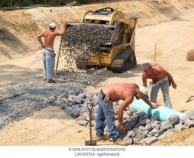 Drainage ditch workers in Massachusetts. USA