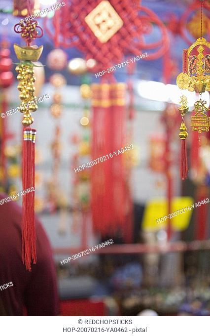 Close-up of good luck charms at a market stall