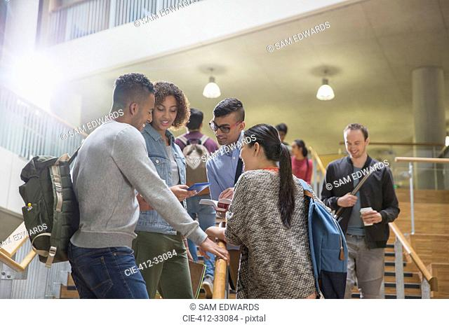 College students talking in stairway