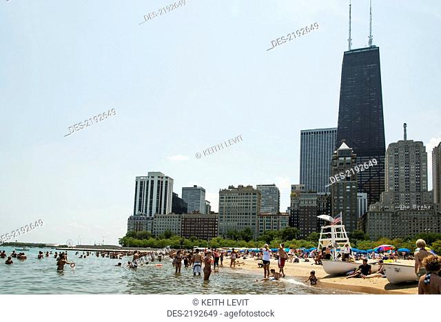 People In The Water And On Beach With Skysers Background Chicago Illinois