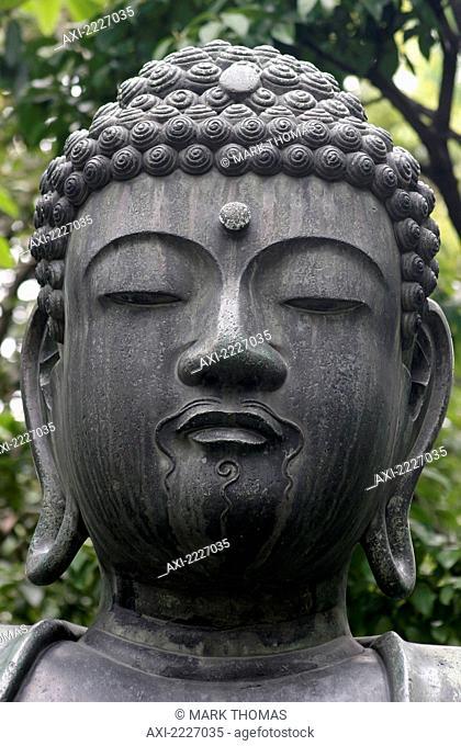 Buddha Statue At The Senso-Ji Temple, Asakusa, Tokyo, Japan - Copyright Mark Thomas/Axiom