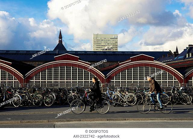 Denmark, Cyclists Passing In Front Of Central Station; Copenhagen