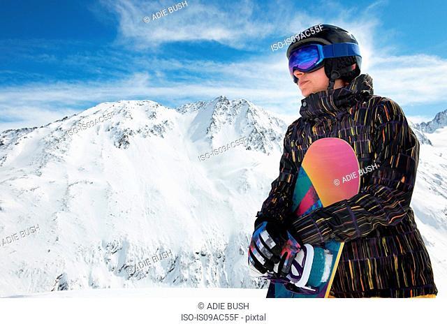 Woman holding snowboard, Obergurgl, Austria
