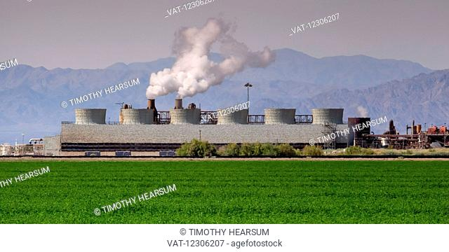 Geothermal power plant as seen in the spring, with an alfalfa field in foreground and mountains in the background located near the Salton Sea in the Imperial...