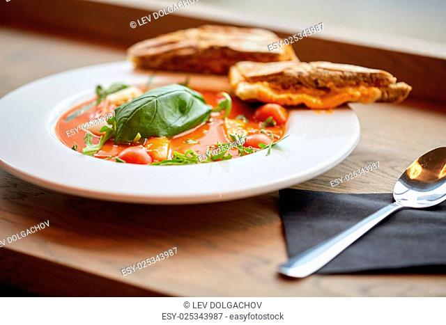 food, dinner, culinary, haute cuisine and cooking concept - plate of delicious gazpacho soup at restaurant
