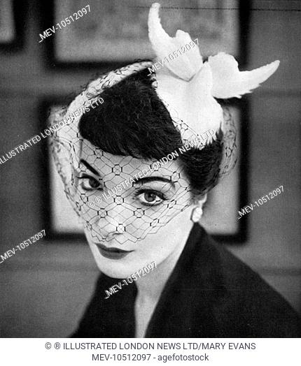 In 1953, you had hats specifically to wear in the afternoon! This one, from Woolland's is the perfect summer complement to a dark town frock (you also had...