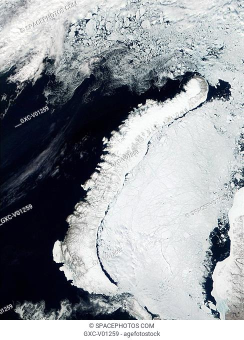 This true-color image shows the island of Novaya Zemlya, which is north of western Russia. To the left of the island are the clear waters of the Barents Sea