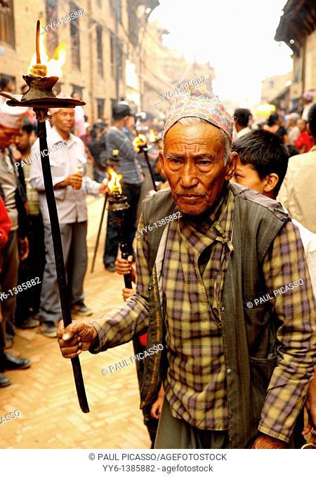 old nepalese man during new year celebrations NAVAVARSHA, the nepalis , life in kathmandu , kathmandu street life , nepal