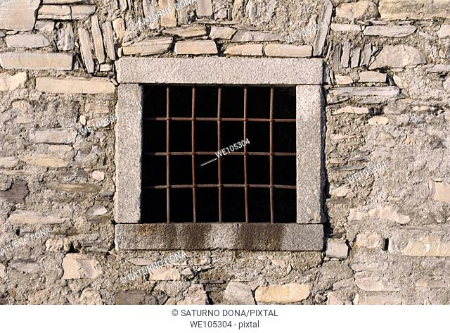 Old prison window with iron bars