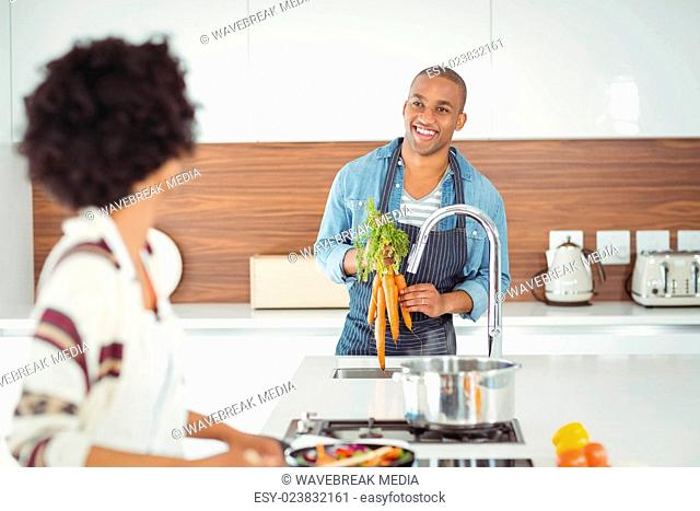 Happy couple preparing meal