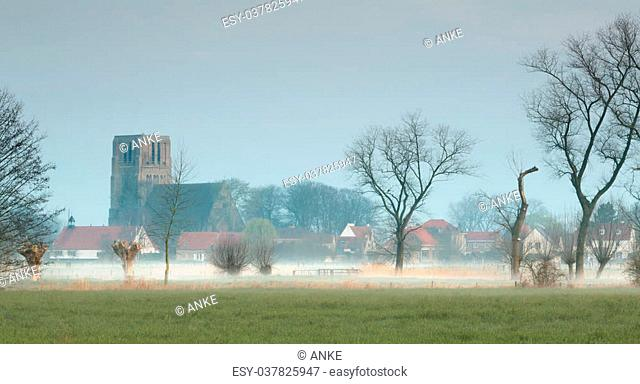 Church of Damme at dawn, one of the most beautiful villages in Flanders Belgium, near Bruges, along the canal Damse Vaart