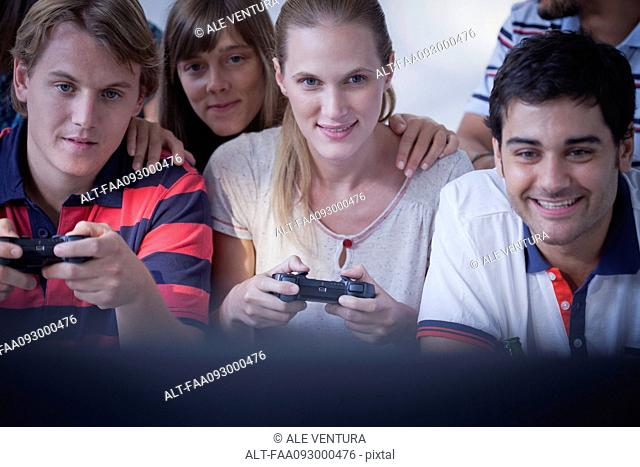 Friends playing video games together