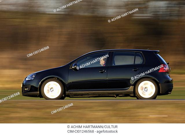 Car, VW Volkswagen Golf GTI, model year 2004-, Limousine, Lower middle-sized class, black, driving, side view, country road